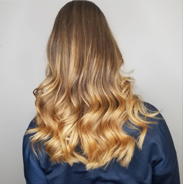 Long golden wavy blonde hair.