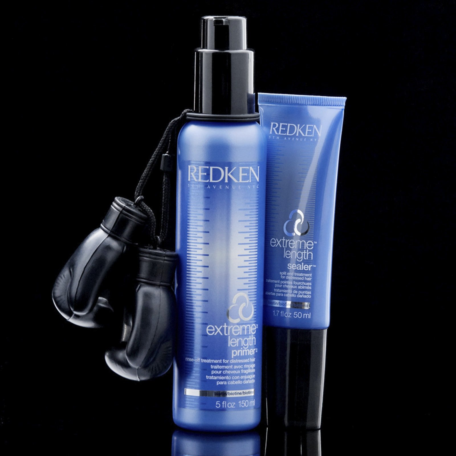 Redken Extreme Primer next to Extreme Split End Sealer and boxing glove.